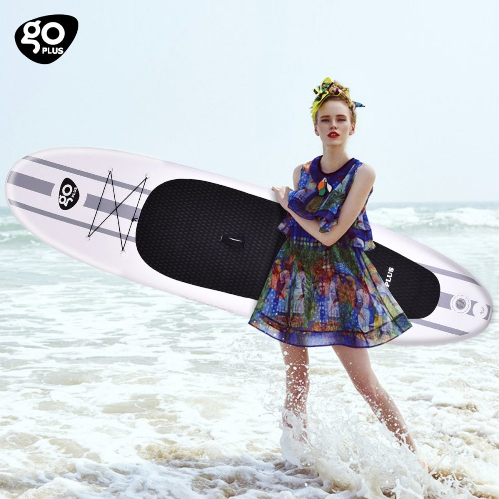 Woman holding Goplus 10' Inflatable Stand Up Paddle Board