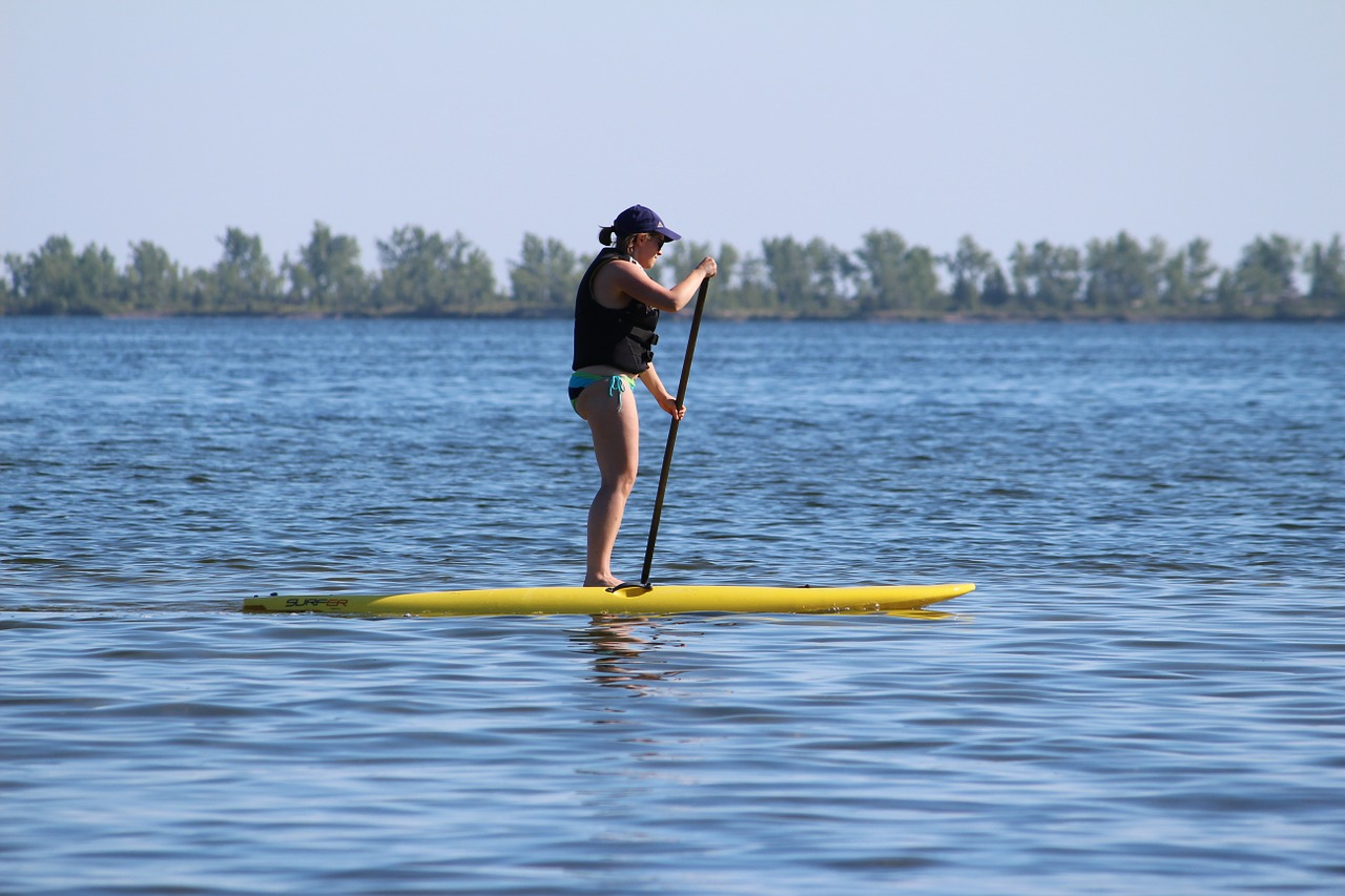 Woman Standing In Paddle Board