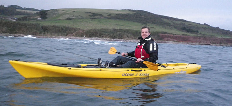 Man riding on his yellow kayak