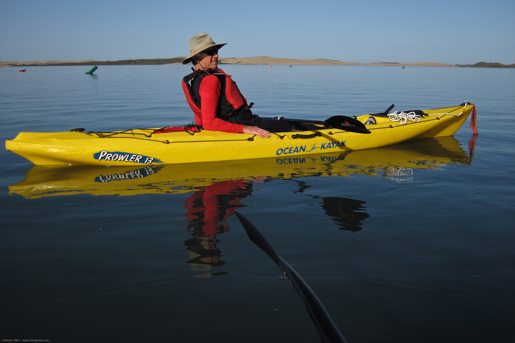 Man riding his yellow kayak