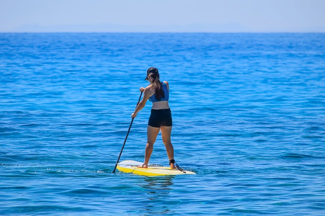 Woman Standing on the paddle board