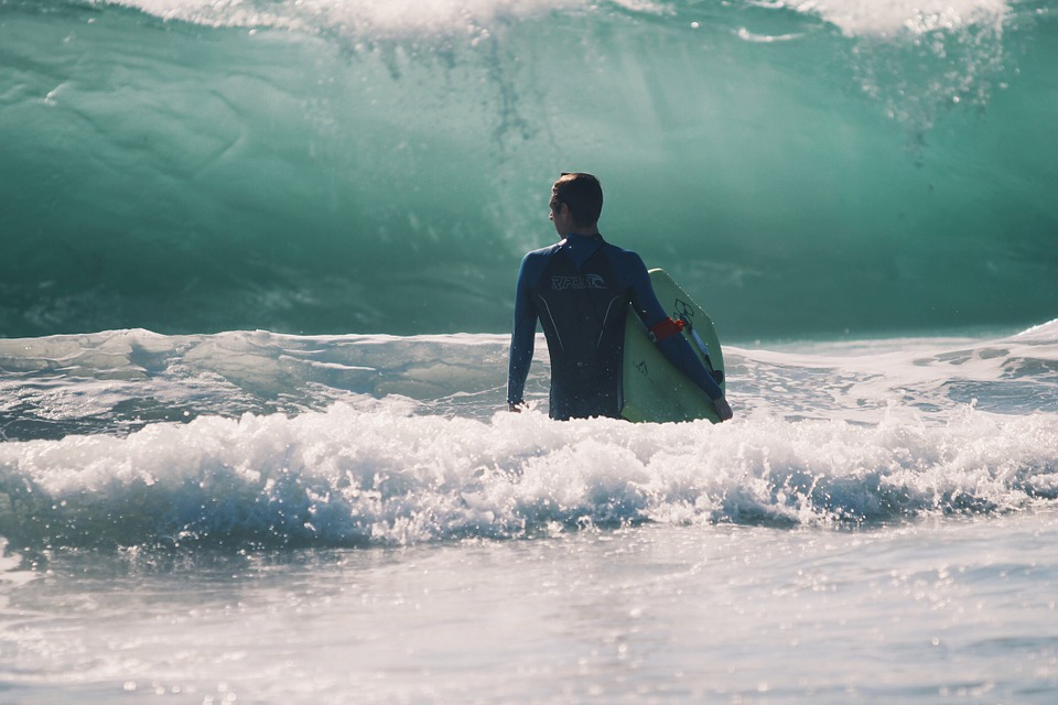 surfer and a big wave