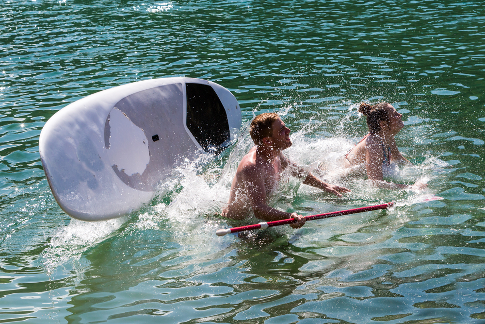 man and woman falling off for Riviera Paddle Board Review of a stand up paddleboard for