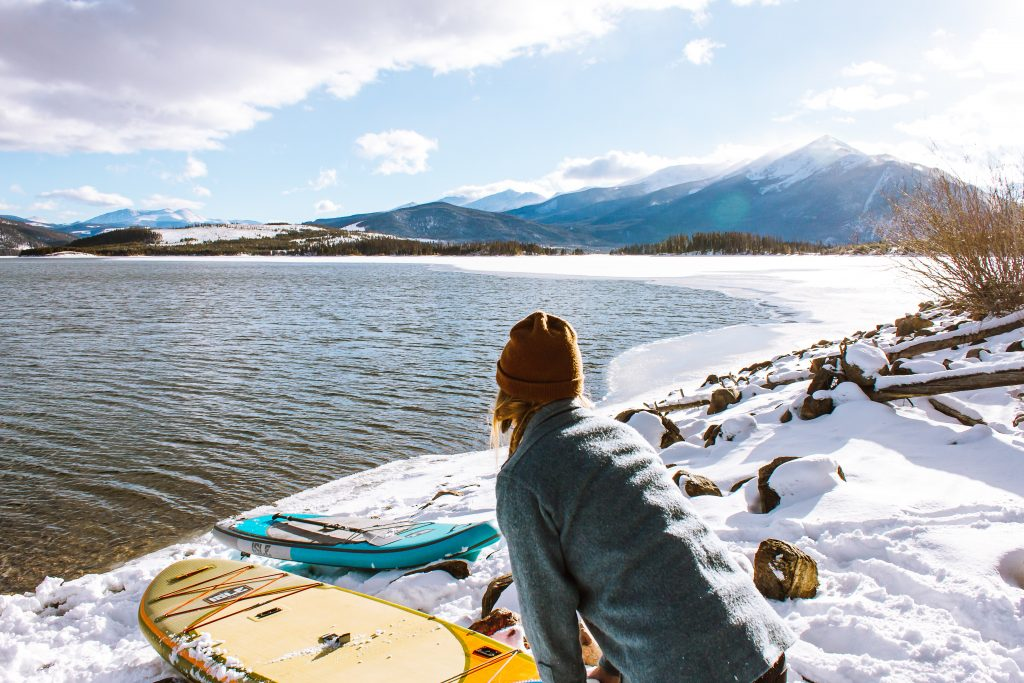 Woman with Paddleboard in winter